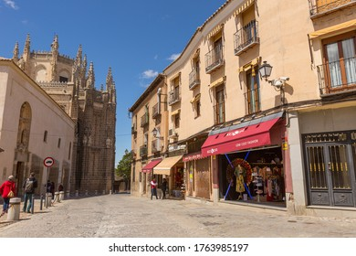 TOLEDO, SPAIN - April 26, 2019: Tourist strolling in a street of the historic district. Toledo, Spain