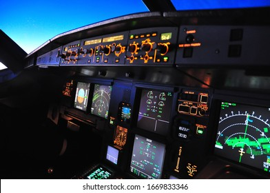 Toledo, Spain - circa 2018: Flight deck of an Airbus A 320 in flight at night taken from the first officer seat