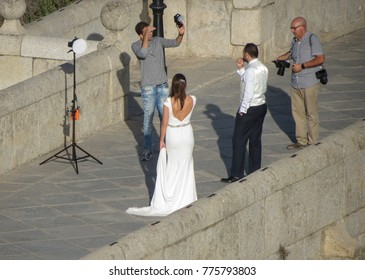 TOLEDO, SPAIN - CIRCA OCTOBER 2017: unidentified bride and groom photo set on the old bridge