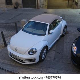 TOLEDO, SPAIN - CIRCA OCTOBER 2017: white Volkswagen New Beetle car