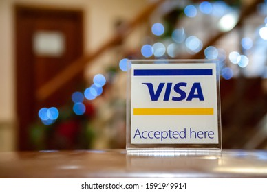 Toledo, Spain, December 2019: Visa sign in a hotel. Accepted here.