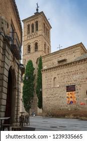 TOLEDO, SPAIN - JULY 07 2016: Mudejar tower of the Iglesia de Santo Tome in the Historic City of Toledo