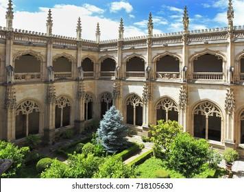 TOLEDO, SPAIN - JUNE 26, 2017: The Monastery of San Juan de los Reyes is an Isabelline style monastery in Toledo, in Castile-La Mancha, Spain, built by the Catholic Monarchs.