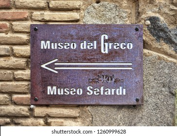 TOLEDO, SPAIN - MARCH 27, 2018: Street sign leading to famous and popular tourist sightings of the city.