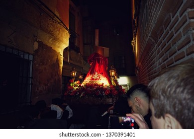 TOLEDO, SPAIN - MARCH 28, 2018: Procession of the Penitent Knights of Christ the Redeemer, which takes place in the middle of the night on Holy Wednesday through the streets of Toledo.