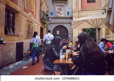 TOLEDO, SPAIN - MARCH 29, 2018: visitors eating in the popular brewery El Trebol near Zokodover square. The Trébol brewery is located inside the old Islamic citadel.