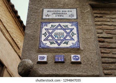 TOLEDO, SPAIN - MARCH 29, 2018: ceramic plate with the name of the ancient district of Toledo - the Jewish quarter. Toledo was declared a World Heritage Site by UNESCO in 1986.