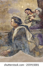 TOLENTINO, ITALY - JULY 17, 2014: cloister of the historic San Nicola church, with frescos and garden. Detail of mural painting