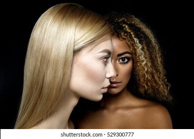 Tolerance. Half faces of two girls. Black and white.