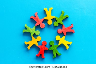 Tolerance, social protection, anti-discrimination concept. Wooden human figures on blue table, top view