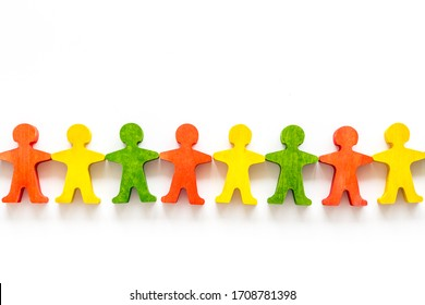 Tolerance, social protection, anti-discrimination concept. Wooden human figures on white table, top view
