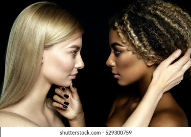 Tolerance. Two girls looking eyes to eyes. Black and white.