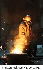 Tolyatti, Samara Region, Russia - February 2020. steelworkers work at the factory and pour metal into special forms.