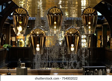 Tom Dixon pendant lights hanging in the Liberty of London store, Regent Street London UK.