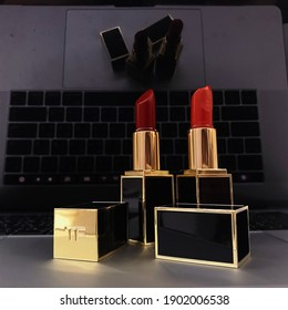 TOM FORD beauty lipstick with luxury packages. The red lip color of TOM FORD collection put on the laptop to present the mixture of nowadays women's lifestyle.
