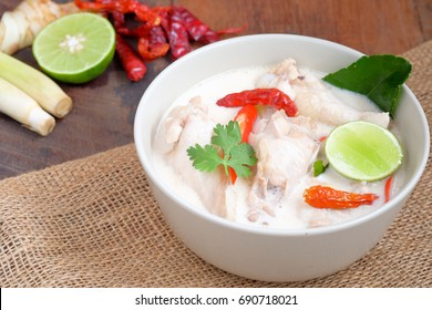 Tom Kha Gai On Wooden Table In Thailand Restaurant ( Chicken coconut soup )