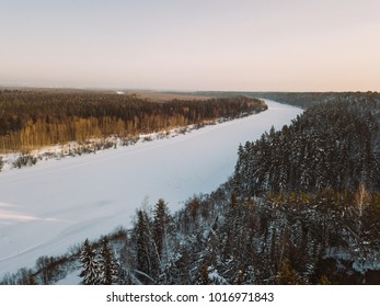 Tom river from aerial view. Taiga forest winter landscape. Nagorny Ishtan, Russia
