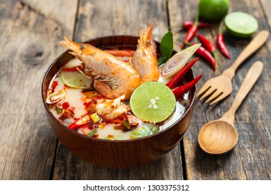 Tom Yam Kung ,Prawn and lemon soup with mushrooms, thai food in wooden bowl top view