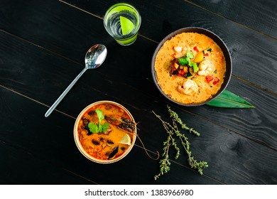 Tom Yam kung Spicy Thai soup with shrimp, seafood, coconut milk and chili pepper in bowl copy space