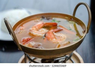 Tom yam kung or Tom yum, Tom yam is a spicy clear soup with shrimps, close up. Popular food in Thailand, thai cuisine