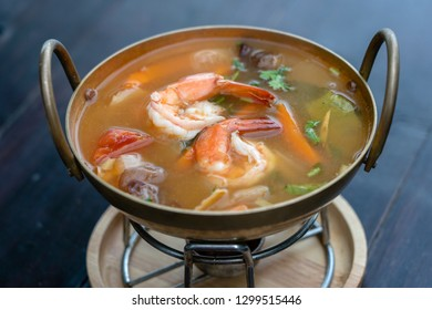 Tom yam kung or Tom yum, Tom yam is a spicy clear soup with shrimps, close up. Popular food in Thailand, thai cuisine concept