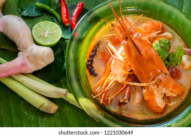 Tom Yam Kung,River prawn spicy soup and Galangal,lemongrass,Lime leaf,lemon,Chili served in a bowl on banana leaf. spicy soup Thai food,on top view