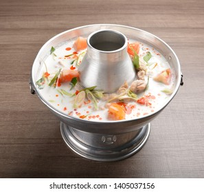 tom yum chicken soup with coconut milk in hot pot
