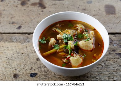 Tom Yum Gai ban,spicy and sour chicken soup on wooden table
