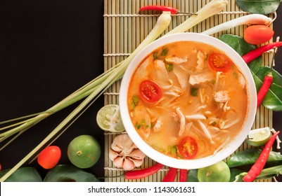 Tom Yum Gai or spicy tom yum soup with chicken - Authentic Thai style food. With ingredients: lemongrass, galangal, kaffir lime leaves, fresh chilies, and lime.