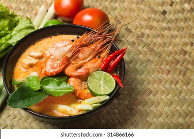 Tom Yum Goong spicy soup with ingredient traditional thai food cuisine in Thailand on mat wicker background