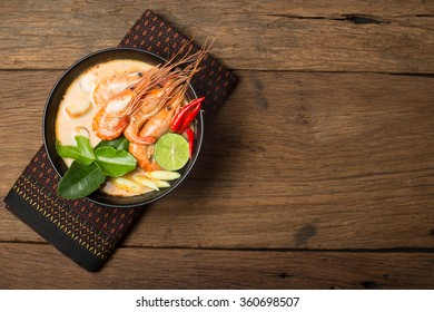 Tom Yum Goong traditional thai food cuisine in Thailand on wooden background