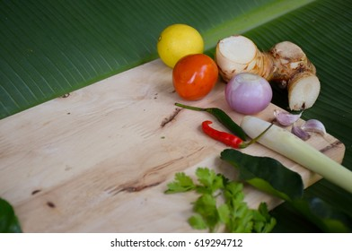 Tom Yum ingredients (hot and sour soup) and wood Block Cooking on banana leaf , Thai food, native food