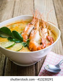 Tom Yum Kung on table wooden