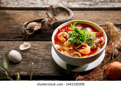 Tom yum kung Spicy soup thai stye menu on wood background