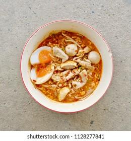 Tom Yum Noodle Soup, Thai food, Noodle soup on concrete background