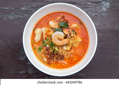 Tom yum seafood on wooden table