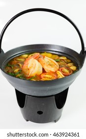 Tom Yum shrimp. Spicy soup with shrimp in a hot pot, Thai cuisine