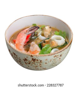 Tom yum soup in a bowl isolated on white background