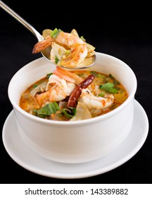 Tom yum or tom yam  is a spicy clear soup typical in Laos and Thailand.