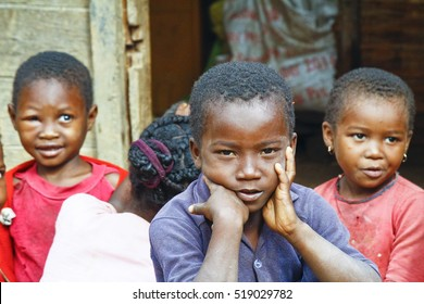 TOMAASINA, MADAGASCAR - August 2014: Unknown african children laughing in Malgasy village.  People in Madagascar suffer of poverty due to slow development of the country