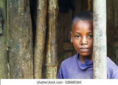 TOMAASINA, MADAGASCAR - AUGUST 2014: Unknown african boy in Malagasy village.  People in Madagascar suffer of poverty due to slow development of the country.