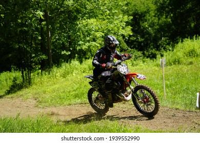 Tomah, Wisconsin USA - October 11th, 2020: Dirt bike riders travel through forest track in a GP motocross race event.