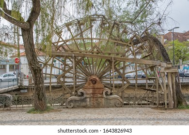 Tomar / Portugal - 04 04 2019 : Full View of a old wooden water mill on downtown Tomar city