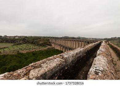 Tomar, Portugal - December 30, 2015: Aqueduto dos Pegões, an aqueduct in the city of Tomar, Portugal