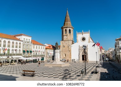 TOMAR,PORTUGAL - OCTOBER 24,2017 - Main square (praca da republica) with a view at the St. John Baptist church and people in Tomar, Portugal.