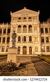 Tomas Garrigue Masaryk statue and Judicial academy building in Kromeriz, Czech republic. Night scene. Architectural theme.