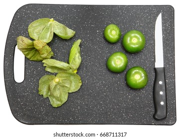 Tomatillo Whole on Cutting Board with Husk and Knife