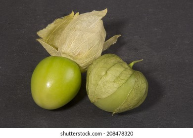 Tomatillos On A Black Slate Background