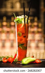 Tomato alcohol cocktail served with fresh vegetables