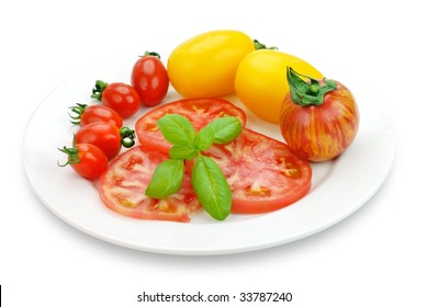 Tomato with Basil Leaf in White Plate